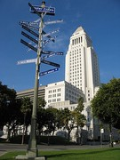 City Hall with a street sign indicating Los Angeles' twin towns and sister cities.