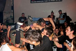A crowd of moshing music fans