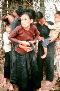 South Vietnamese women and children in Mỹ Lai before being killed in the massacre, 16 March 1968. [27] According to court testimony, they were killed seconds after the photo was taken.[28] The woman on the right is adjusting her blouse buttons following a sexual assault that happened before the massacre.[29]