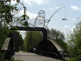 "Naburn railway bridge near York, showing ""The Fisher of Dreams"" iron cage sculpture[9]"
