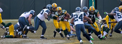 Ryan Grant running through the line for a 56-yard touchdown against Seattle.