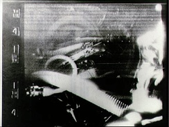 Cooper in an SSTV broadcast from Faith 7