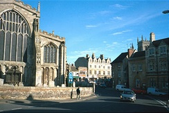 All Saints' Church with the wooden war memorial, and Red Lion Square to the right