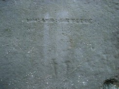 Graffiti on the sarsen stones include ancient carvings of a dagger and an axe