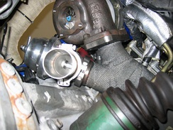 An external wastegate installed next to the turbocharger.