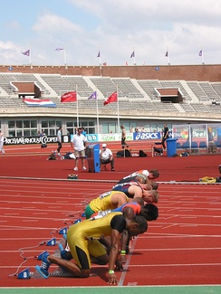 Men assuming the starting position for a sprint race