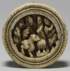 Anglo-Norman 12th-century gaming piece, illustrating soldiers presenting a sheep to a figure seated on a throne