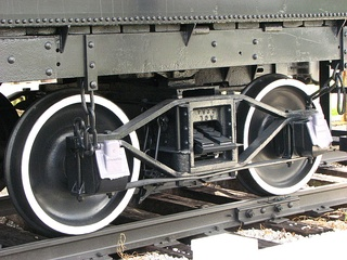 Archbar bogie with journal bearings in American style journal boxes, as used on some steam locomotive tenders. Archbar bogies (trucks) were also used on freight cars.
