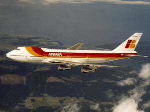 A 747-200 in Iberia livery in flight, over land
