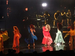 "Beyoncé and her female dancers performing ""Freakum Dress"" during a concert. For the performance of the song they wore long dresses in different colours."