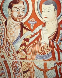 Blue-eyed Central Asian monk teaching an East Asian monk. A fresco from the Bezeklik, dated to the 9th or 10th century; although Albert von Le Coq (1913) assumed the red-haired monk was a Tocharian,[19] modern scholarship has identified similar Caucasian figures of the same cave temple (No. 9) as ethnic Sogdians,[20] an Eastern Iranian people who inhabited Turfan as an ethnic minority community during the phases of Tang Chinese (7th-8th century) and Uyghur rule (9th-13th century).[21]
