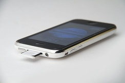 iPhone 3G shown with the SIM tray partially ejected