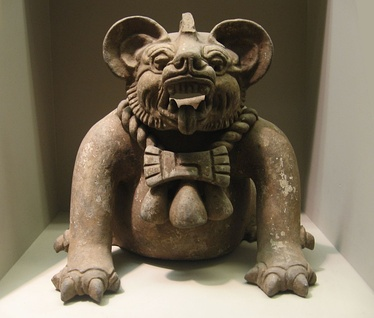 "A funerary urn in the shape of a ""bat god"" or a jaguar, from Oaxaca, dated to AD 300–650. Height: 9.5 in (23 cm)."