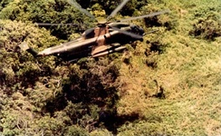 An HH-53C lowering a PJ during a rescue mission, June 1970