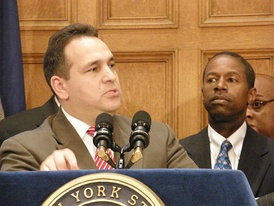 Hiram Monserrate announces he is leaving the coalition and returning to the Democrats as Malcolm Smith looks on.