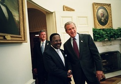 President George W. Bush welcomes President Omar Bongo to the Oval Office, May 2004