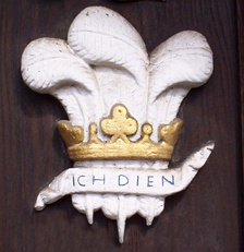 Prince of Wales's feathers, relief sculpture on the main gate, a heraldic badge used by members of college