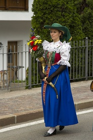 Young woman wearing traditional dirndl during sacramental procession, Seis am Schlern, South Tyrol, 2014. (Photograph by Marco Delnoij)