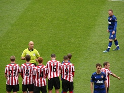 Rooney lines up a free kick against Sunderland on the final day of the 2011–12 Premier League season. Despite Rooney's winner, United lost out on the league title to Sergio Agüero's last minute goal for Manchester City.