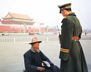 A Falun Gong adherent sitting in Tiananmen Square