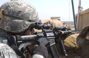A U.S. Army soldier in March 2007 wears a helmet with a UCP camouflage cover during the Iraq War
