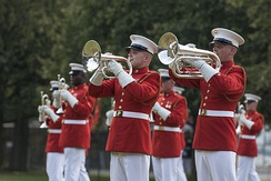 The United States Marine Drum and Bugle Corps performed at the Marine Corps War Memorial in 2015.