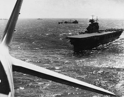 Yorktown conducts aircraft operations in the Pacific sometime before the battle. A fleet oiler is in the near background.