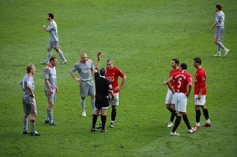 Footballer Nemanja Vidić is shown a red card and ejected from a soccer match