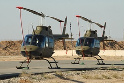A pair of Bell 206's sit on the tarmac