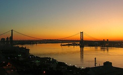 The Ben Franklin Bridge, viewed at sunrise from Center City toward Camden, New Jersey