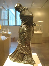 Greek bronze statuette of a veiled and masked dancer, 3rd–2nd century BC, Alexandria, Egypt.