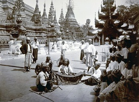 Burmese musicians performing at the Shwedagon Pagoda in 1895.