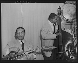 Two members of Duke Ellington's rhythm section at the Hurricane Ballroom: a jazz guitarist and an upright bass player.