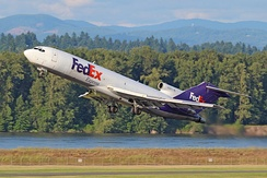 A FedEx Express 727-233 departs Portland International Airport