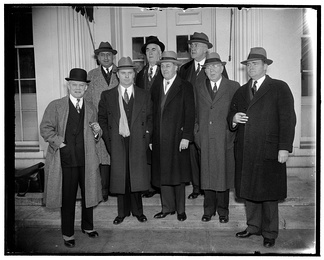 Group of legislators leaves White House after asking Franklin D. Roosevelt for $80,000,000 for flood control in Ohio Valley, March 7, 1938. front: l-r Joseph A. Dixon, James G. Polk, Eugene B. Crowe, G W Johnson, Lawrence E. Imhoff, rear l-r : Peter J. De Muth, Kent E. Keller, Brent Spence.