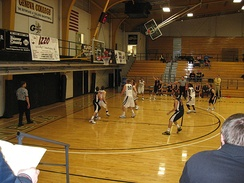 Cairn's basketball team (black jerseys) playing at Geneva College