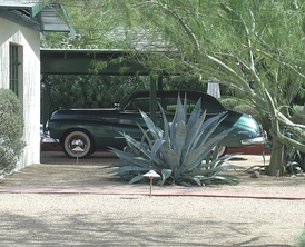 L. Ron Hubbard's car, a 1947 Buick Super 8. The car is parked behind the house