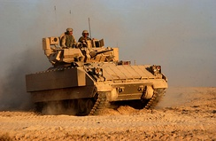 M2A3 Bradley operating near Fallujah, Iraq, in November 2004. The main recognition feature of the M2/M3A3 is the Commander's Independent Viewer (CIV), at the right rear of the turret.