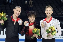 Rippon (right) at the 2016 Skate America podium