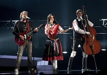 Barbara Ogrinc (middle) and Rok Modic (right) of Roka Žlindre performing with Matjaž Švagelj of Kalamari at Eurovision Song Contest 2010
