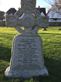 "The headstone of Spike Milligan's grave in the grounds of St Thomas' Winchelsea, East Sussex. The name of his last wife was added along with birth and death dates and an additional epitaph. Spike Milligan's epitaph includes the phrase Dúirt mé leat go raibh mé breoite, Irish for ""I told you I was ill"".[58] The headstone is positioned roughly midway between the New Inn and the church door."