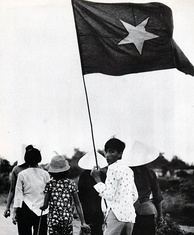 Civilians in a NVA/Viet Cong controlled zone. Civilians were required to show appropriate flags, during the War of the flags