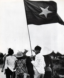 Civilians in a PAVN/NLF controlled zone. Civilians were required to show appropriate flags, during the War of the flags.[308]