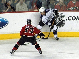 Los Angeles Kings' Mike Weaver clearing the puck away from Calgary Flames' Daymond Langkow, December 21, 2005.
