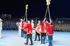 A Tajik military band with Karnays at a military tattoo at Zhurihe Training Base in the Chinese autonomous region of Inner Mongolia, 2014