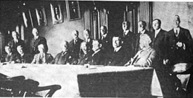 The 1916 United States Assay Commission met on February 9 and February 10, 1916, to test coins from the previous year to ensure they met specifications. Among the members and Mint officials shown were then-Mint Director Robert W. Woolley (standing fourth from left), Engraver of the United States Mint at Philadelphia Charles E. Barber (standing third from left) and Philadelphia Mint Superintendent Adam Joyce (standing at far right).