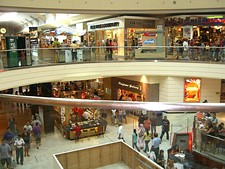 Interior of Westfield Garden State Plaza in Paramus, whose 07652 zip code produces over $5 billion in retail sales annually, top in the United States[206][207] (above); and Downtown Ridgewood, one of many pedestrian-oriented municipal commercial centers in Bergen County (below).