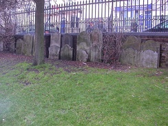 Gravestones in the former burial ground now line the walls of the former Hanover Chapel burial ground.