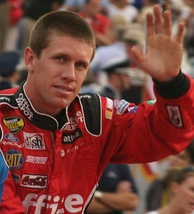Carl Edwards (pictured in 2007) finished in third after losing his chance of the victory at the green–white–checker restart.