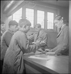 Boys buy sweets from the tuck shop at Ampleforth in 1943